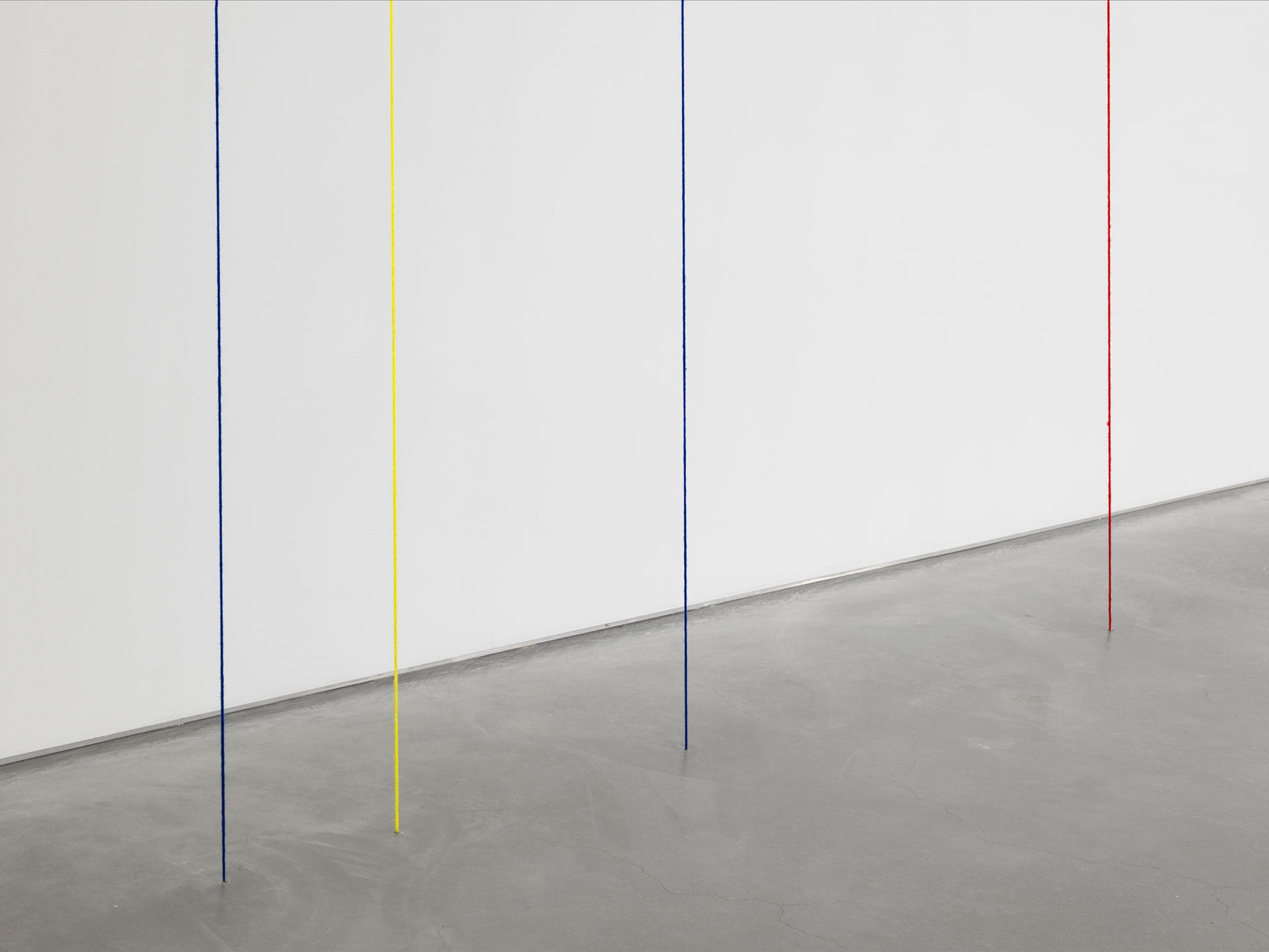 A detail from a sculpture by Fred Sandback, titled Untitled (Six-part Leaning Construction), dated 1985.