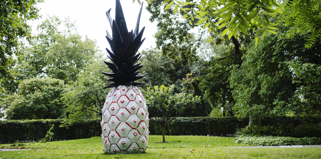 Installation view of a sculpture by Rose Wylie at Frieze Sculpture in London, titled Pineapple, dated 2020.