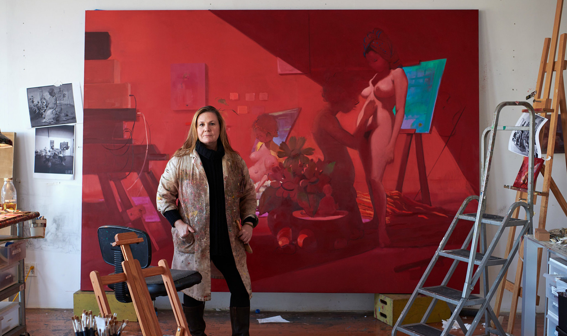 A detail of a photo of Lisa Yuskavage in her Brooklyn studio, standing in front of a work in progress, in 2020. The photo is by Jason Schmidt.