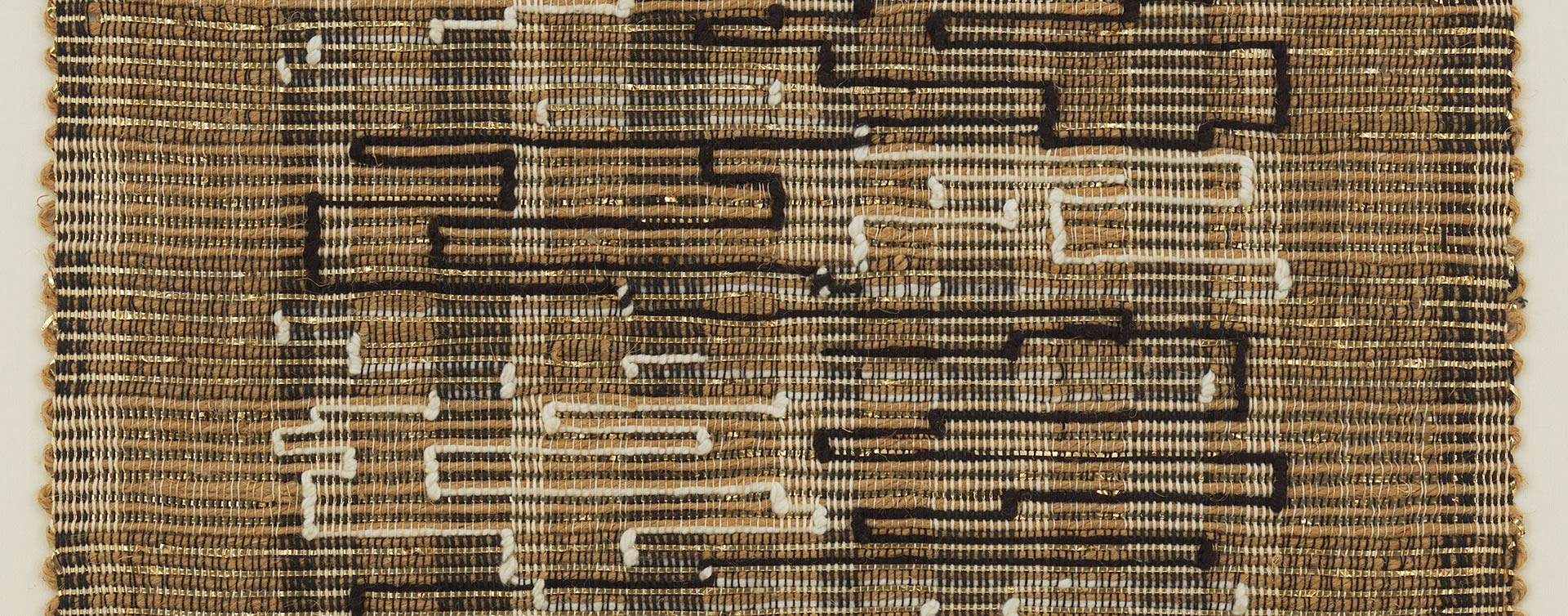 A detail from a textile by Anni Albers, titled Black-White-Gold I,dated 1950.