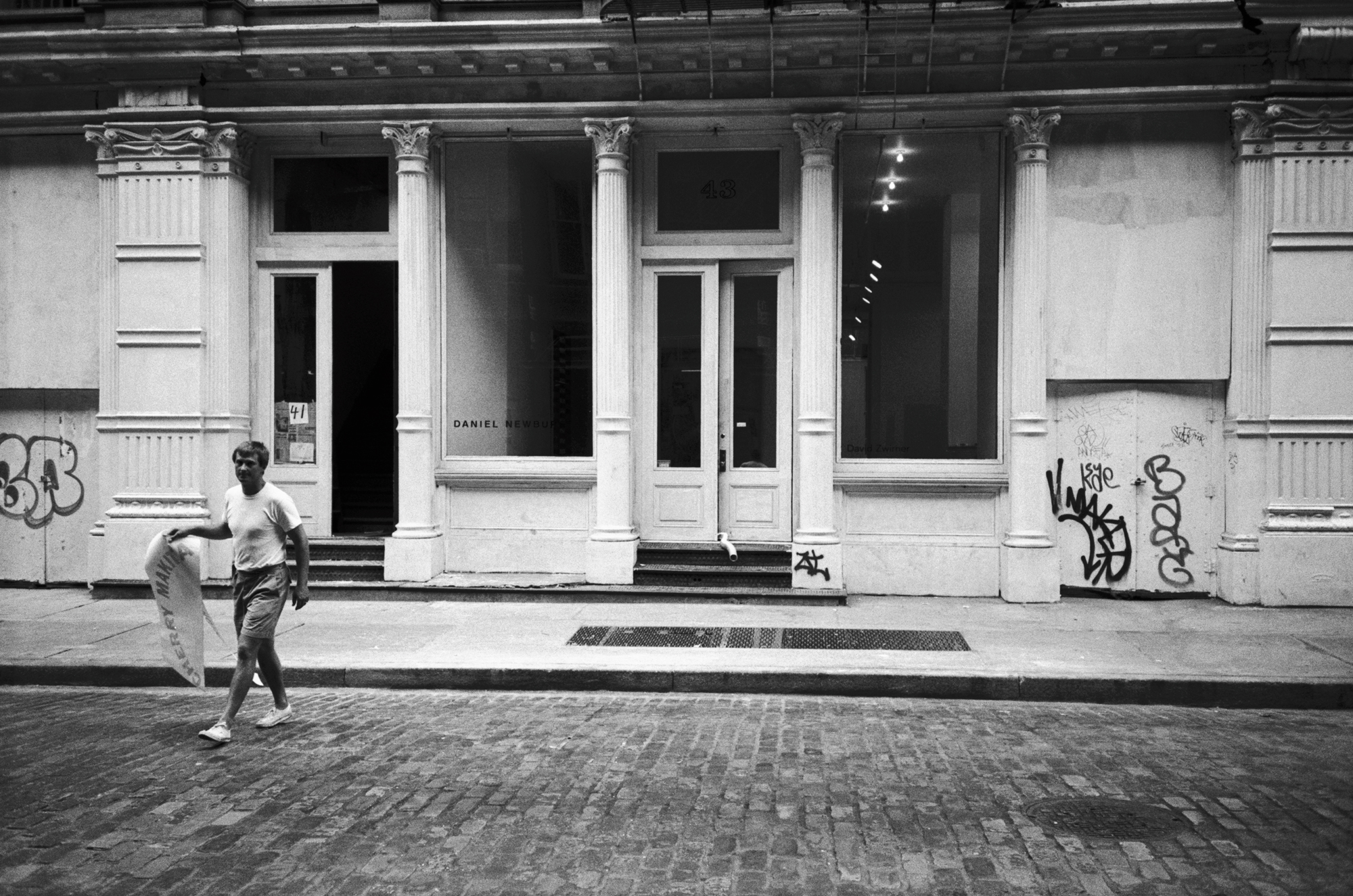 A photograph of David Zwirner outside of 43 Greene Street in New York, dated 1993.