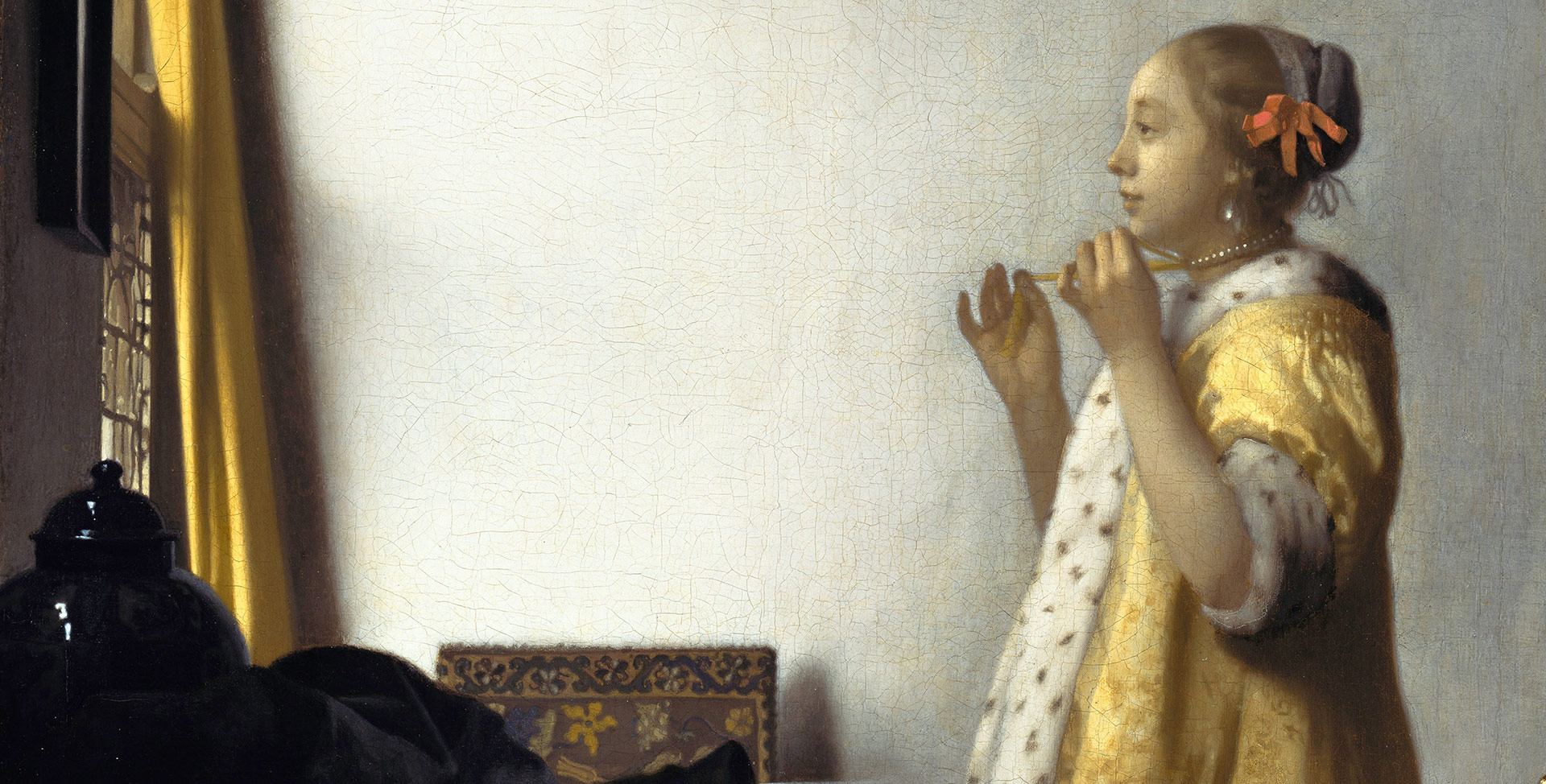 A detail from a painting by Johannes Vermeer, titled Young Woman with a Pearl Necklace, dated 1664.