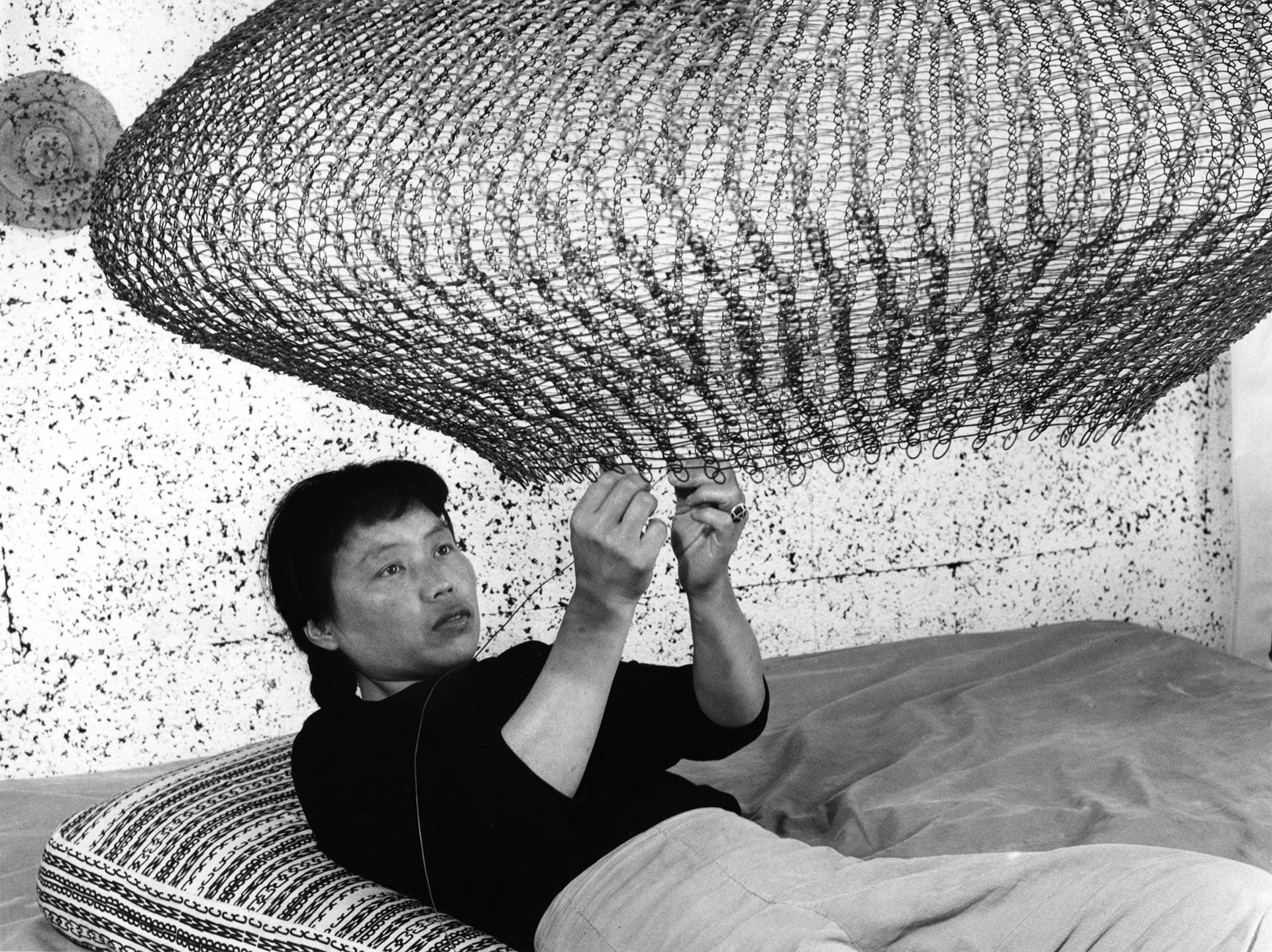 A photograph of Ruth Asawa by Imogen Cunningham, dated 1957.