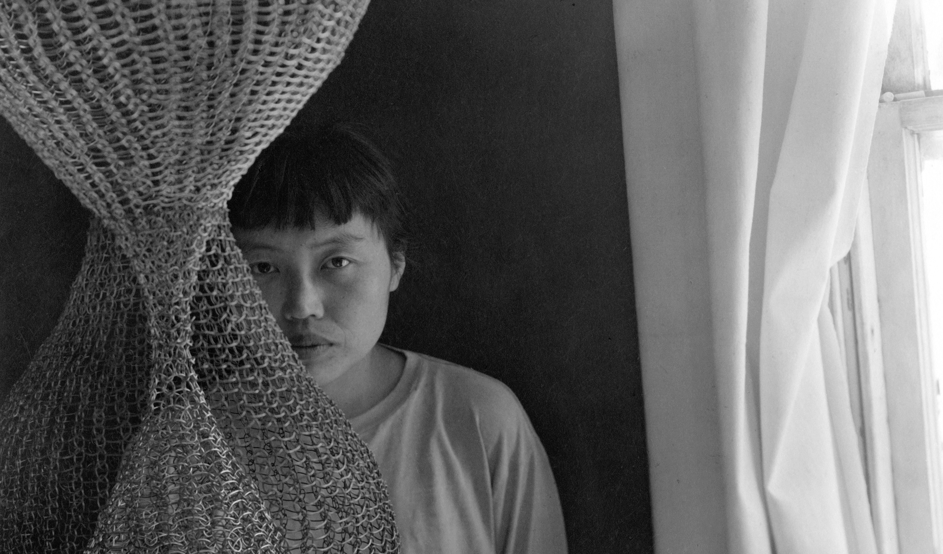 A detail of a photograph of Ruth Asawa, dated 1950s.