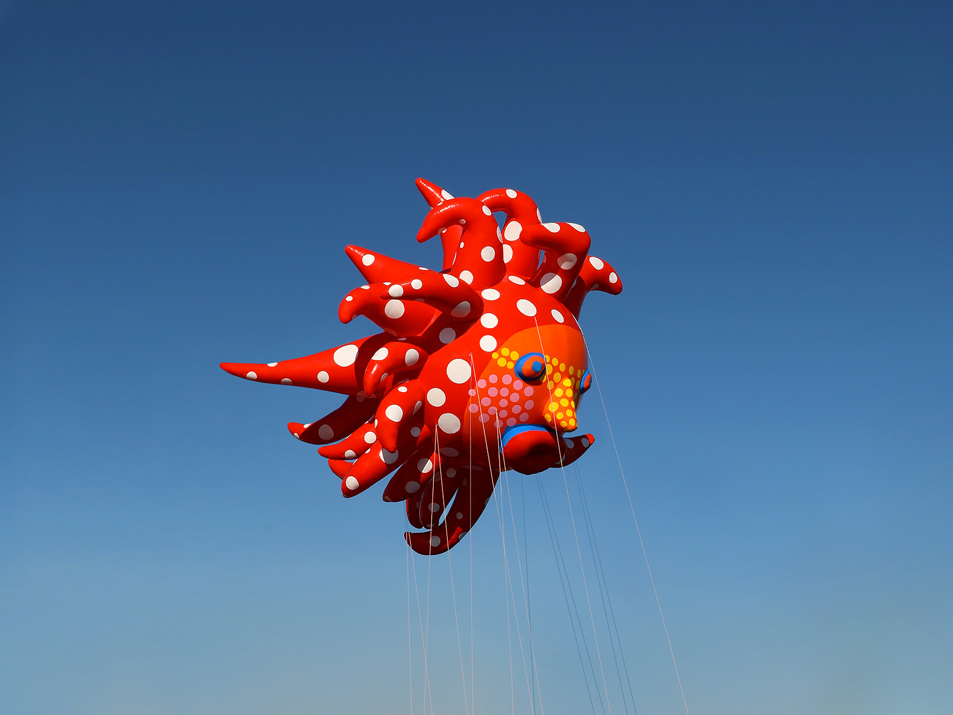A photo of a balloon by Yayoi Kusama, titled Love Flies Up to the Sky, dated 2019.