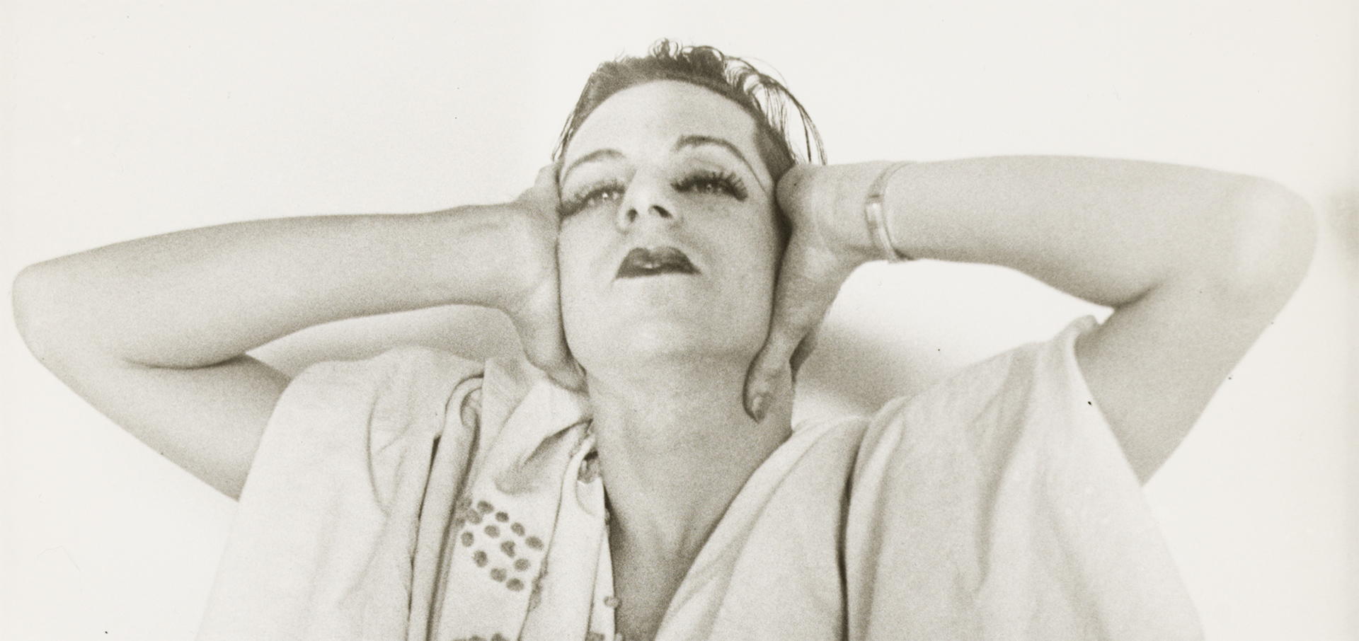 A detail from a photograph by Charles Henri Ford, titled Parker Tyler in Drag, dated c. 1940-1943.