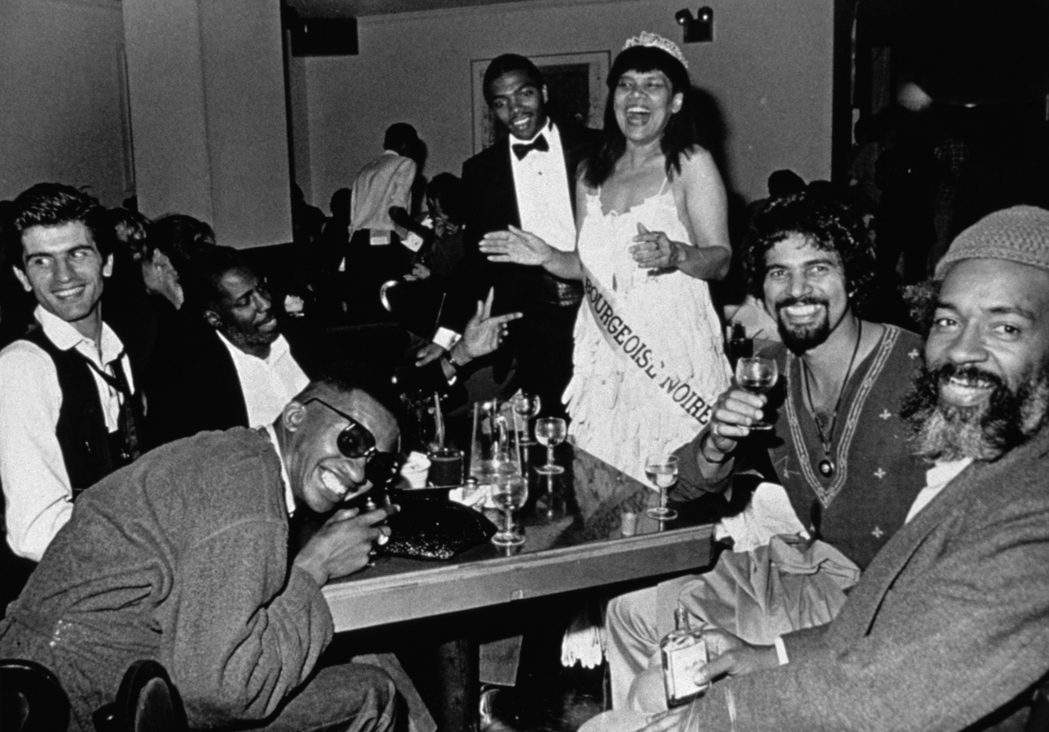 A photo by Lorraine O'Grady, titled Untitled (Mlle Bourgeoise Noire celebrates with her friends), dated 1980-83/2009.